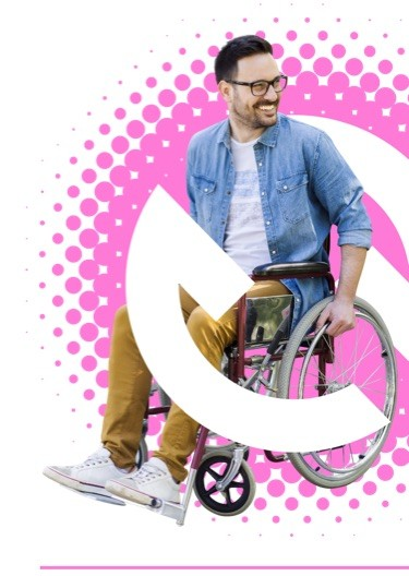 Smiling young white man in casual clothing in a wheelchair outdoors